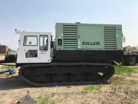 Morooka MST 1500VD with attached SULLAIR 170PSI / 825CFM Air Compressor. Supports odex and air rotary drilling capable of containing all pipe, tooling