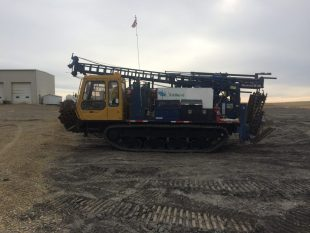 Morooka MST1500 with attached Diedrich D-120. This drill is a brute of power and possibilities. It is equipped with a Progressive Cavity 3L8 Moyno Pump and 1m3 Heated water tank. It has 4 winches, 5' Top Drive Stroke and a 5 speed gear selection with High/Low. GVW - 16,531 Kg HEIGHT MAST DOWN - 3.3m WIDTH - 2.62m FULL MAST HEIGHT - 9.5m HALF MAST HEIGHT - 4.5m MAX SPEED - 12Km/Hr GROUND PSI - UNDER 6PSI