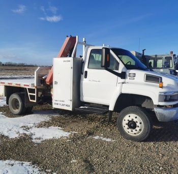 2007 GMC C5500 5 TON Picker Truck with Flat Deck. Capable of handling & hauling soil bags for disposal. GVWR 11,793Kg