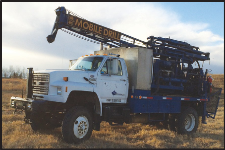 Ford F800 4x4 with attached B-57 Mobile Drill. The drill is a multi-purpose rig capable of many different drilling styles. It comes equipped with a Progressive Cavity 3L6 Moyno Pump, 3 Winches, 5' Top Drive stroke and a 5 Speed gear selection with High/Low. Optional 1 m3 heated water tank.  GVWR - 14,500 Kg LENGTH - 7.62m HEIGHT - 3.8m WIDTH - 2.62m FULL MAST HEIGHT - 7.92m HALF MAST HEIGHT - 4.26m